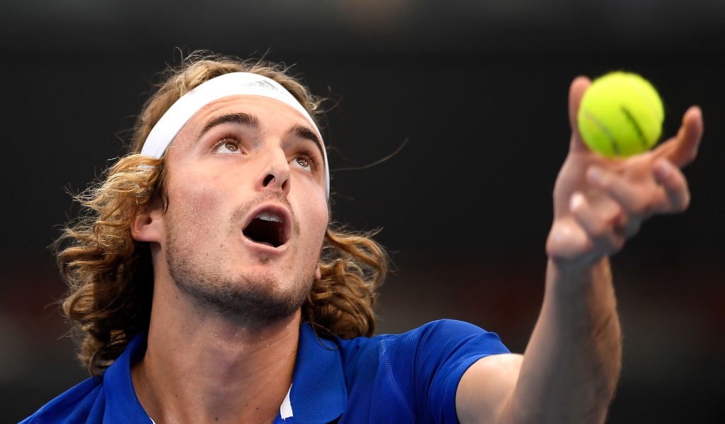 Stefanos Tsitsipas serving