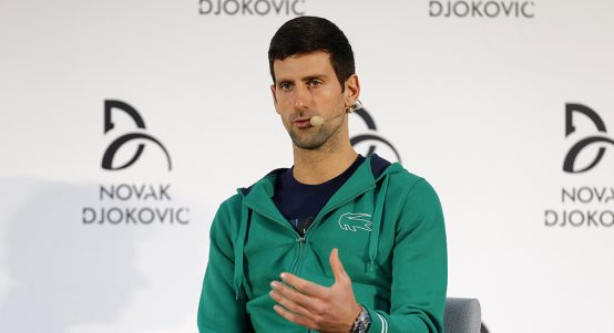 Novak Djokovic talks to press
