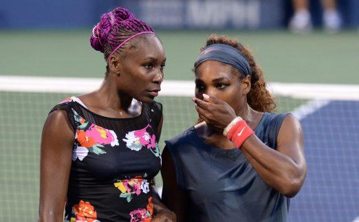 Venus Williams and Serena Williams in action