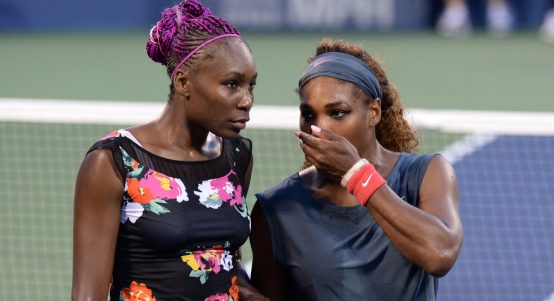 Venus Williams and Serena Williams in action