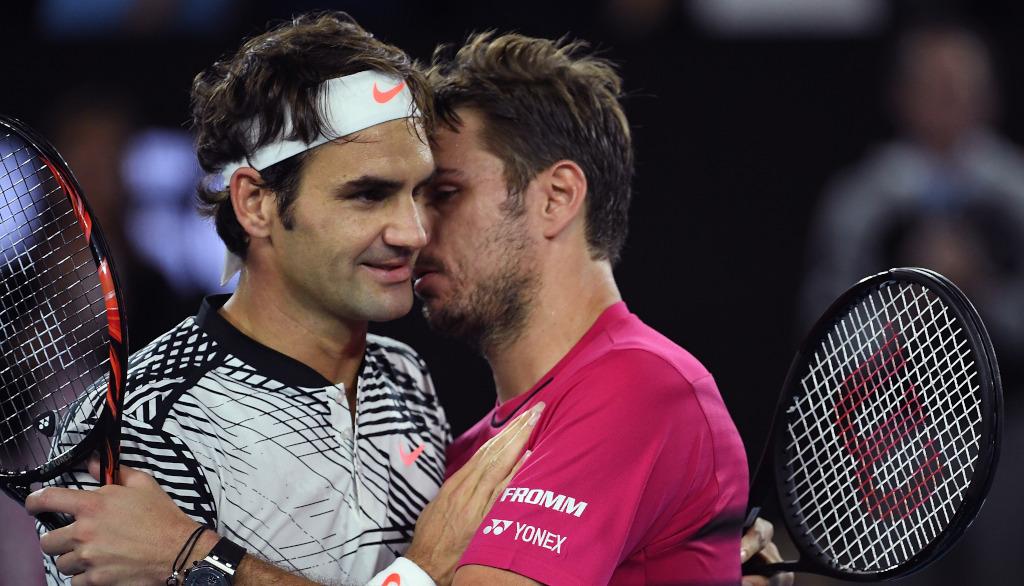 Roger Federer and Stan Wawrinka hugging