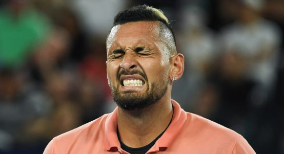 Nick Kyrgios grimacing