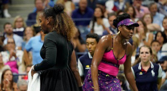 Serena Williams and Venus Williams in action