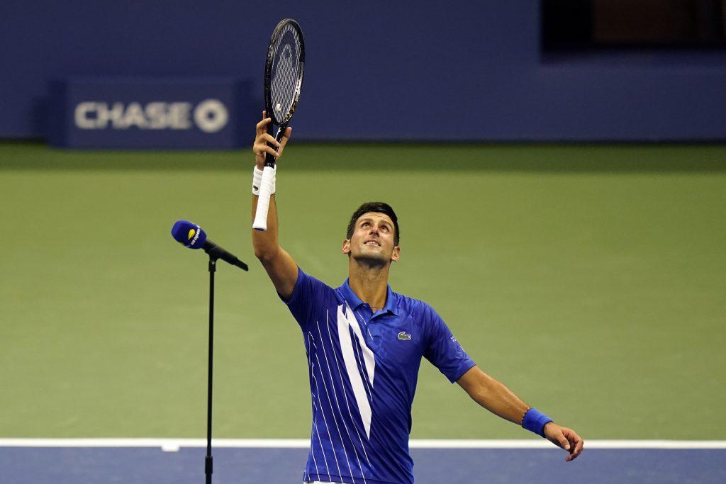 Novak Djokovic taking the applause