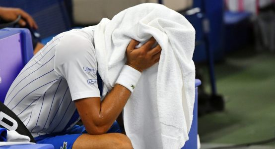 Novak Djokovic under a towel