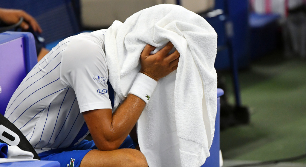 Novak Djokovic under a towel