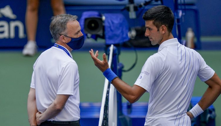 Novak Djokovic talks with tournament officials