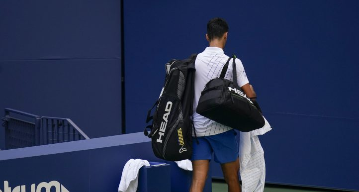Novak Djokovic leaves the court after US Open default