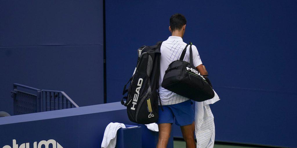 Novak Djokovic leaves the court after US Open default