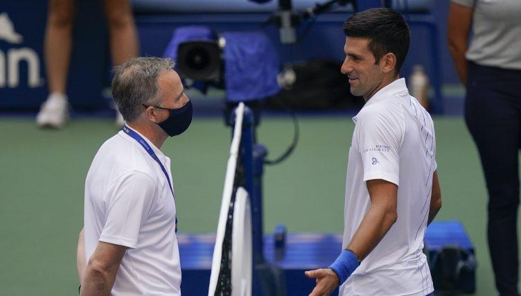 Novak Djokovic talks to US Open tournament officials