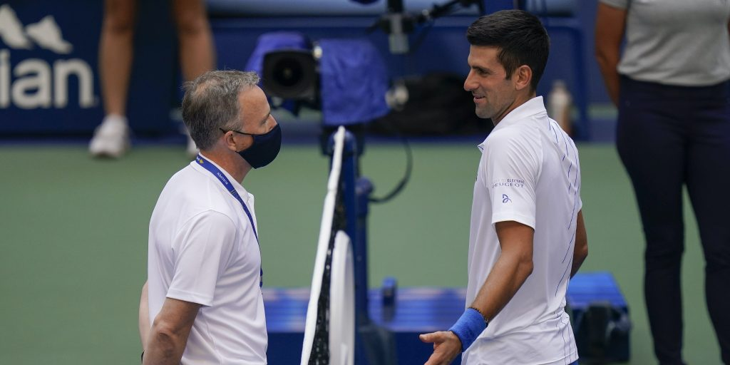 Novak Djokovic talks to US Open tournament officials