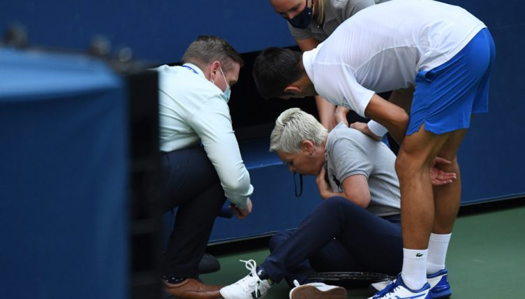 Novak Djokovic with line umpire he injured at US Open