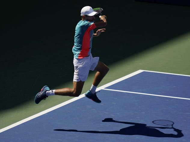 Alex De Minaur leaps into a return during his victory over Vasek Pospisil