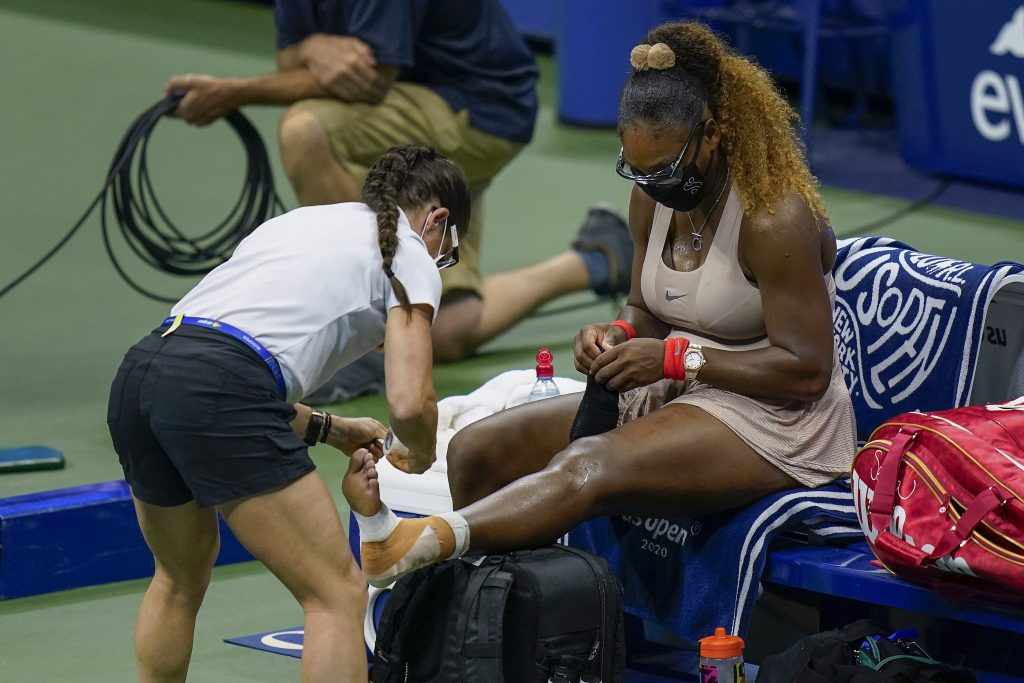 Serena Williams receiving treatment