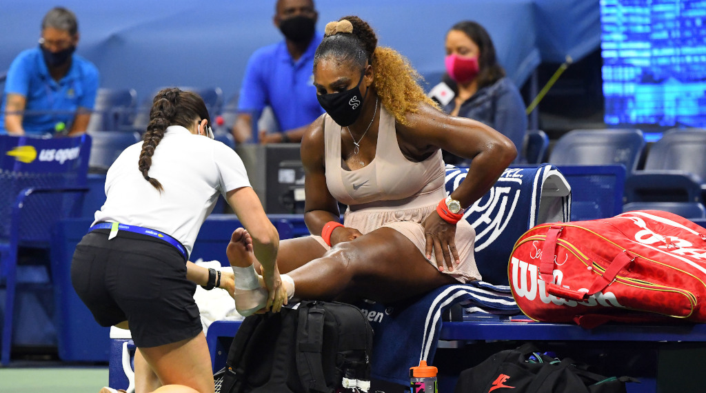 Serena Williams receives treatment on her foot