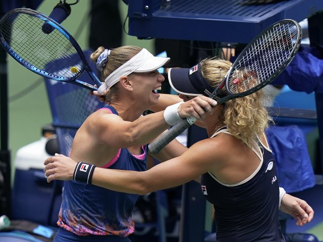 Vera Zvonareva, left, and Laura Siegemund got the thumbs up for a hug