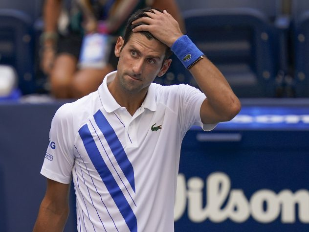 Novak Djokovic looks shocked after his disqualification from the US Open