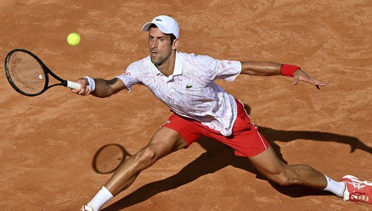 Novak Djokovic sliding