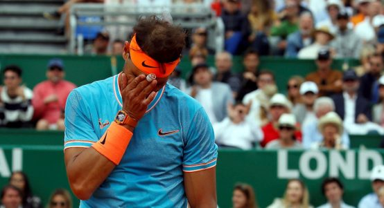 Rafael Nadal wipes his face