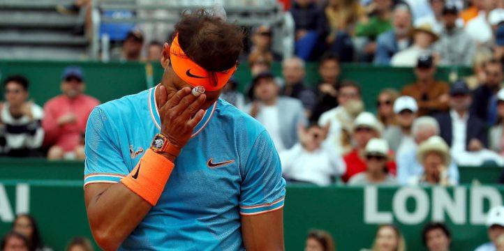 Rafael Nadal wipes his face