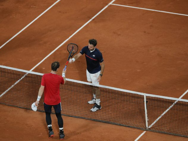 Andy Murray and Stan Wawrinka touch rackets at the end of the match