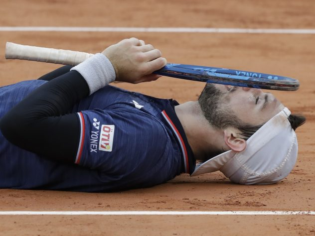 Austria's Jurij Rodionov celebrates his five-set win over France's Jeremy Chardy