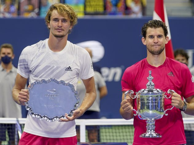 Alexander Zverev, left, with his runner-up trophy in New York alongside champion Dominic Thiem