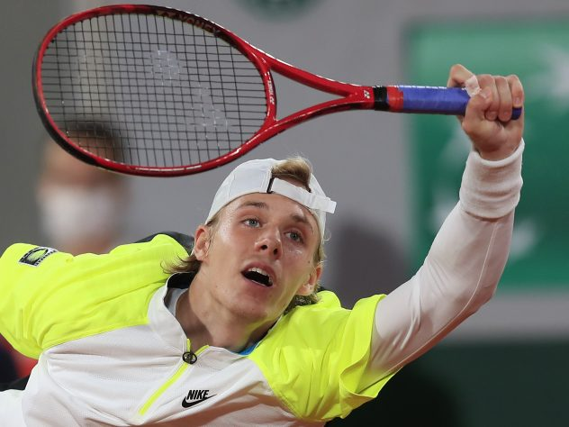 Denis Shapovalov plays a forehand at full stretch
