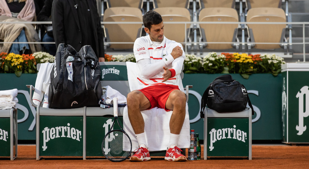 Novak Djokovic feeling his shoulder