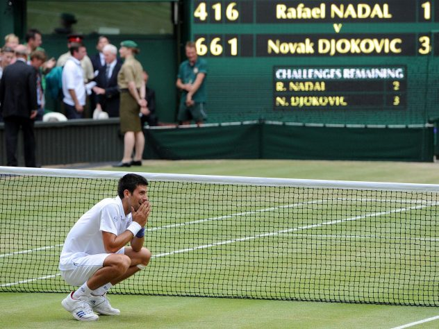 Novak Djokovic celebrates his win over Rafael Nadal at Wimbledon 2011