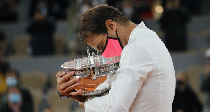 Rafael Nadal hugs French Open trophy