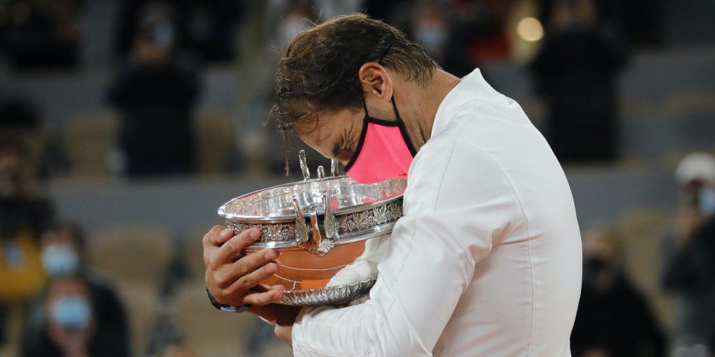 Rafael Nadal hugs French Open trophy
