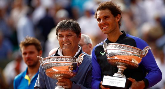 Toni Nadal and Rafael Nadal with French Open trophies