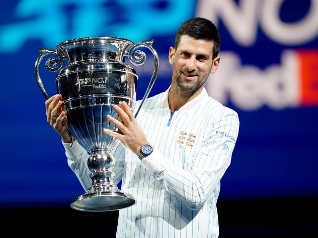 Novak Djokovic poses with his year-end ATP number one trophy