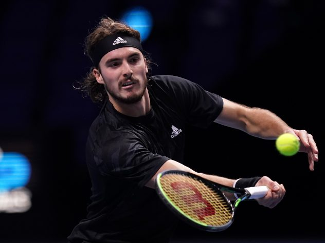 Stefanos Tsitsipas plays a volley during his defeat by Rafael Nadal