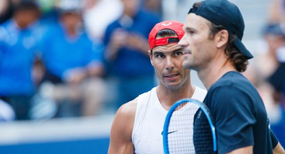 Rafael Nadal and Carlos Moya talking tactics