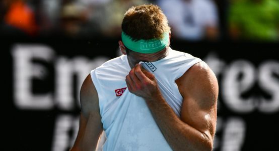 Tennys Sandgren wipes his face