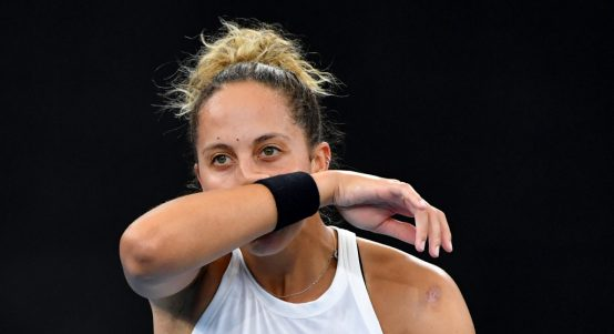 Madison Keys wipes her face