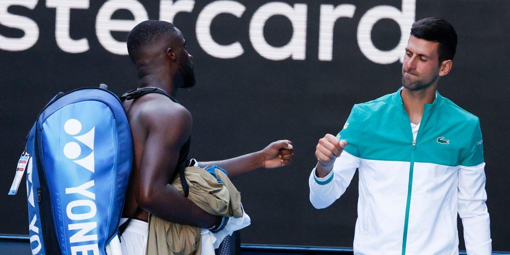 Frances Tiafoe and Novak Djokovic fist pump