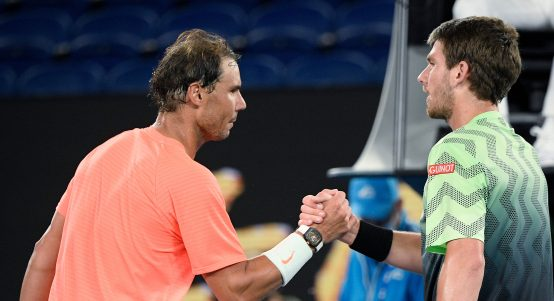 Rafael Nadal and Cameron Norrie shake hands