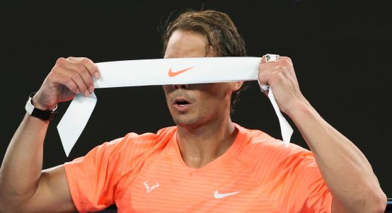 Rafael Nadal changes his headband
