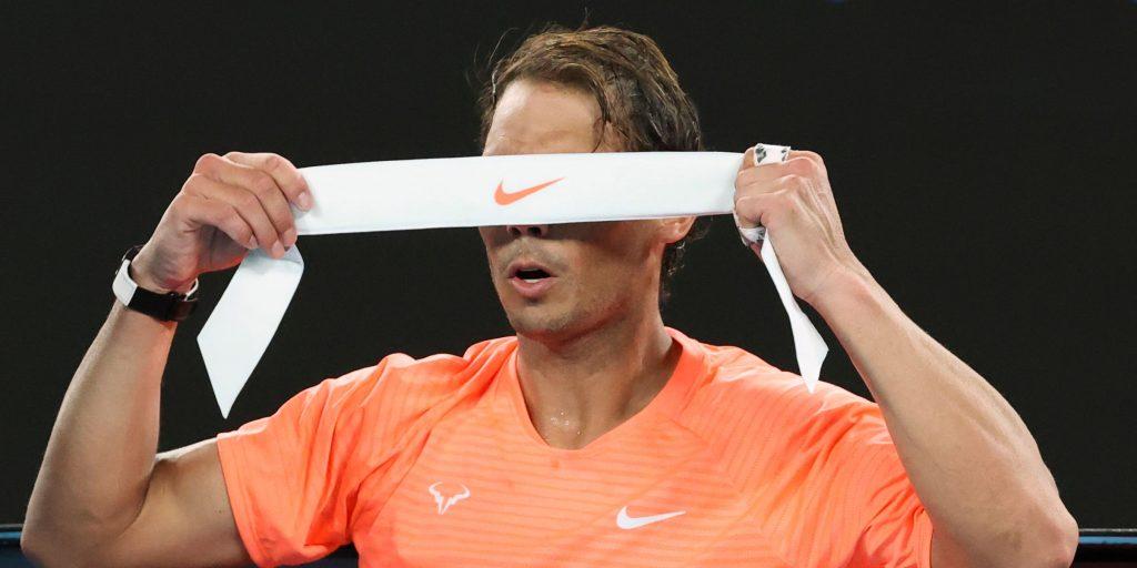 Rafael Nadal changes his headband