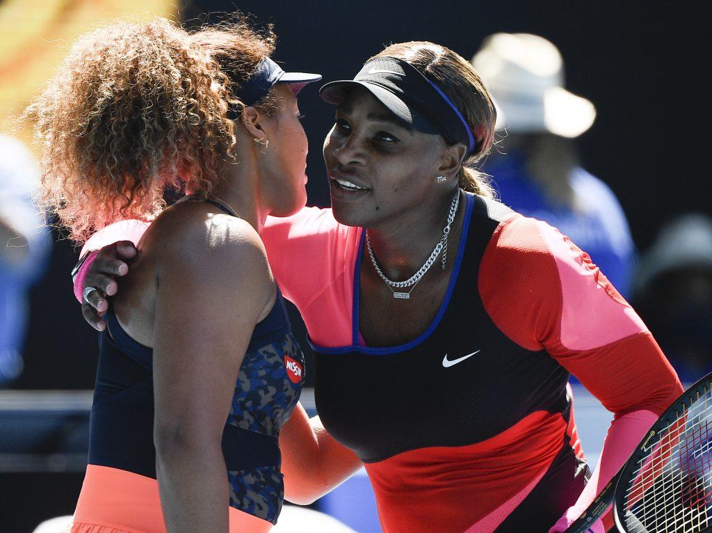 Naomi Osaka and Serena Williams hugging