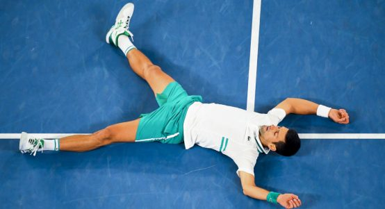 Novak Djokovic hits the turf