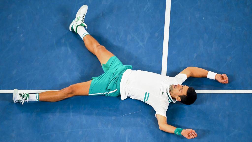 Novak Djokovic hits the turf