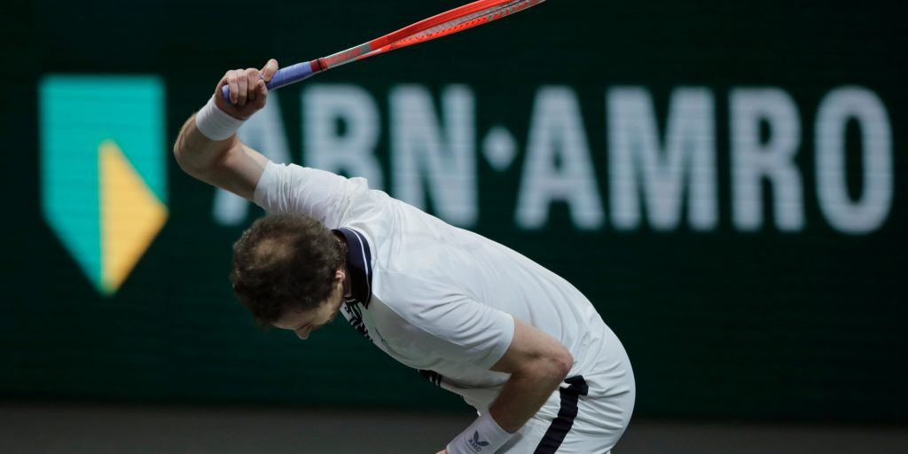 Andy Murray smashes his racket