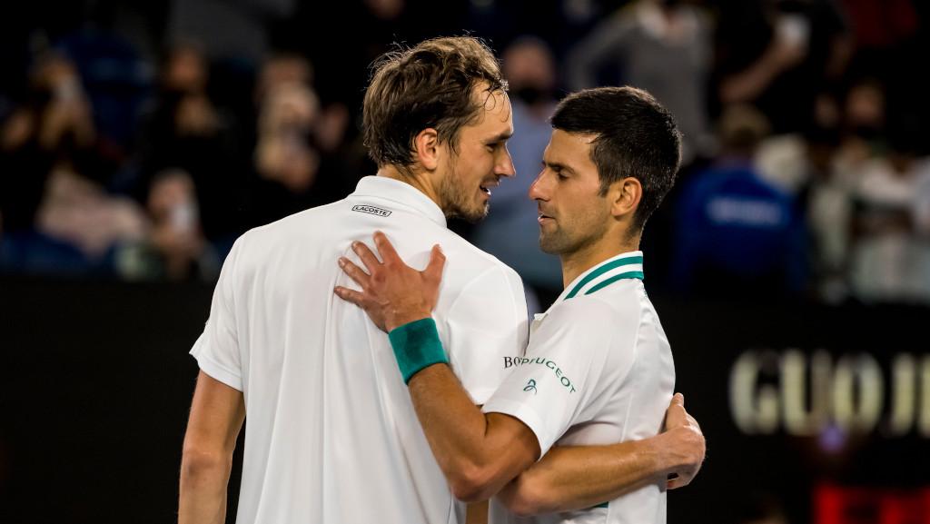 Daniil Medvedev and Novak Djokovic hugging