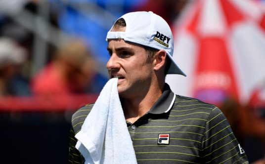 John Isner with a towel