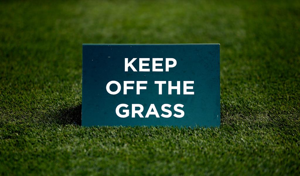 Wimbledon grass sign