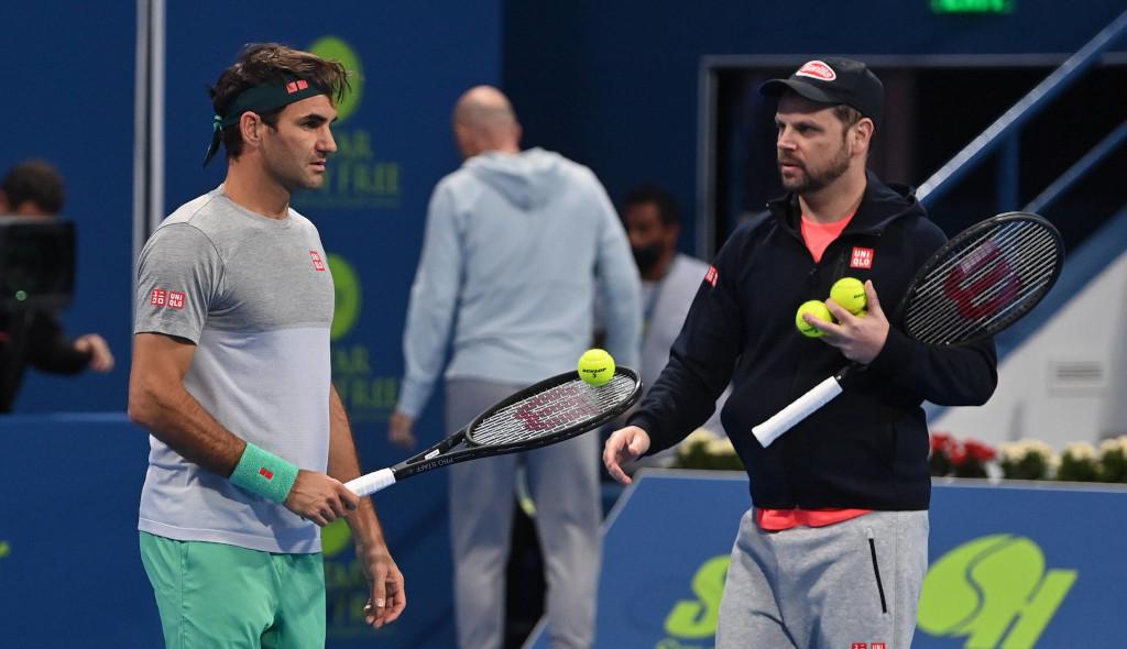 Roger Federer and Severin Luthi at practise